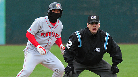 Players (and umps) have to bundle up with hoods and gloves on cold days.